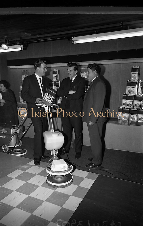 23/03/1966<br /> 03/23/1966<br /> 23 March 1966<br /> Exhibition of Columbus-Dixon Floor Maintenance Equipment and a range of Johnson Wax products run by Goodbody Ltd. at the Building Centre, Dublin. Pictured at the event are Mr Gerry O'Donoghue, Service Products Representative, Goodbody Ltd.; Mr Con O'Dwyer, Joint Managing Director, O'Dwyer Brothers, Licensed Premises, Pearse Street, Dublin and Mr Patrick Munnelly, Building Contractor, (Dublin) viewing some of the products.