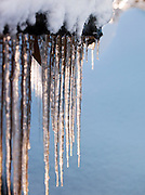 Icicles hang from a frozen rooftop in Kirkeness, Finnmark region, northern Norway