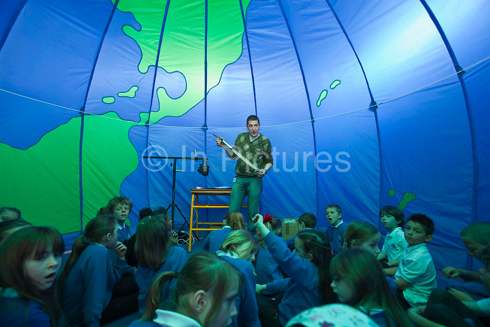A workshop run by Camp Kernow, a Cornwall based organisation teaching sustainable development to primary school pupils. Year 3 pupils at St. Columb Minor school, Cornwall, take part in a discussion about sustainable development inside a large globe style tent. The school won an Ashden Award in 2010 for it's appraoch to sustainable energy.