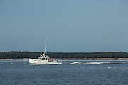 McGlathery Island, ME - 11 August 2014. Lobsterboat Mainely Texas motoring west past McGlathery Island.