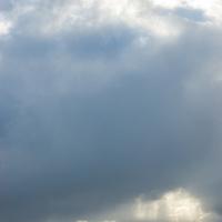 Clouds and sun over Magdalena Channel & Isla Capitan Aracena, Tierra del Fuego, Chile.