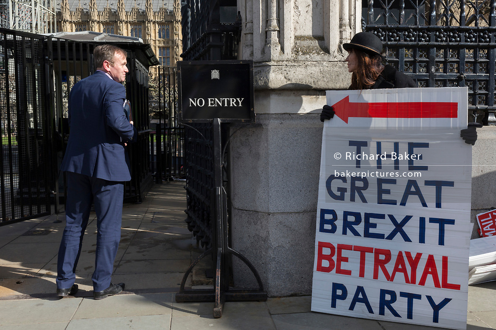 On the day that MPs in Parliament vote on a possible delay on Article 50 on EU Brexit negotiations by Prime Minister Theresa May, George Eustice, MP for Camborne, Redruth & Hayle, exchanges words with Brexiteer activists as they protest at the gates of the House of Commons, on 14th March 2019, in Westminster, London, England.