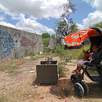 Aug 12, 2010 - Reynosa, Mexico - Waiting in an alley that minutes before had been filled with residents, a young child waits for her father who is in the food line at the Frank Ferree distribution point in the colonia of Satelite Uno..(Credit Image: © Josh Bachman/ZUMA Press)