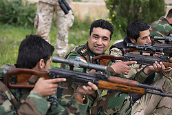 © Licensed to London News Pictures. 30/03/2015. Erbil, Iraq. Kurdish peshmerga snipers practice judging distances using the scopes on their Romanian PSL sniper rifles during a training package run by coalition forces instructors at a military training area near Erbil, Iraq.<br /> <br /> The training is part of a four week long package, the first to be held with a complete peshmerga battalion, run by coalition forces mobile training teams (MTT) in Kurdistan with the aim to make the peshmerga more efficient in combatting the Islamic State. Photo credit: Matt Cetti-Roberts/LNP