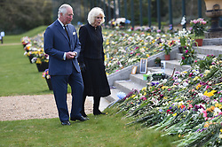 EMBARGOED TO 1100 THURSDAY APRIL 15 The Prince of Wales and the Duchess of Cornwall visit the gardens of Marlborough House, London, to view the flowers and messages left by members of the public outside Buckingham Palace following the death of the Duke of Edinburgh on April 10. Picture date: Thursday April 15, 2021.