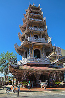 """Linh Phuoc Pagoda is called the """"bottle temple"""" because there is a dragon having covered with fragments of broken bottles of beer.  Visitors enjoy the unique architecture carved into a dragon shape.  In front of the pagoda and temple Long Hoa Vien which is a 7 storey tower, On the first floor there is a Great Bell considered the largest bell in Vietnam today weighing over 8 tons."""