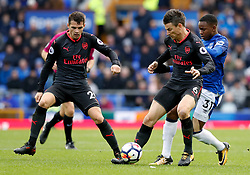 Arsenal's Laurent Koscielny (centre) and Everton's Ademola Lookman (right) battle for the ball