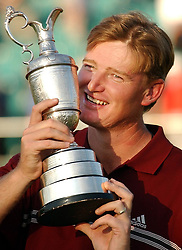 South Africa's Ernie Els kisses the trophy after winning the 131st Open Championship in a play-off involving France's Thomas Levet at Muirfield, Scotland.