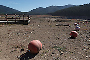 USA, Oregon, Detroit Lake State Recreation Area,buoys marking area for boats on Detroit Lake,  high and dry in the drought of 2015.