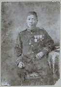 very old and damaged photo of decorated Japanese soldier 1900s