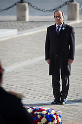 French President Francois Hollande pays respect after laying a wreath of flowers at the Tomb of the Unknown Soldier under the Arc de Triomphe during Armistice Day ceremonies marking the 98th anniversary of the end of World War I, in Paris, France on November 11, 2016. Photo by Jeremy Lempin/ABACAPRESS.COM