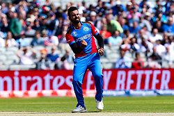 Dawlat Zadran of Afghanistan celebrates taking the wicket of James Vince of England - Mandatory by-line: Robbie Stephenson/JMP - 18/06/2019 - CRICKET- Old Trafford - Manchester, England - England v Afghanistan - ICC Cricket World Cup 2019 group stage