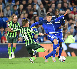 Dannie Bulman of AFC Wimbledon tackles Alex Revell of Cardiff City - Mandatory by-line: Paul Knight/JMP - Mobile: 07966 386802 - 11/08/2015 -  FOOTBALL - Cardiff City Stadium - Cardiff, Wales -  Cardiff City v AFC Wimbledon - Capital One Cup