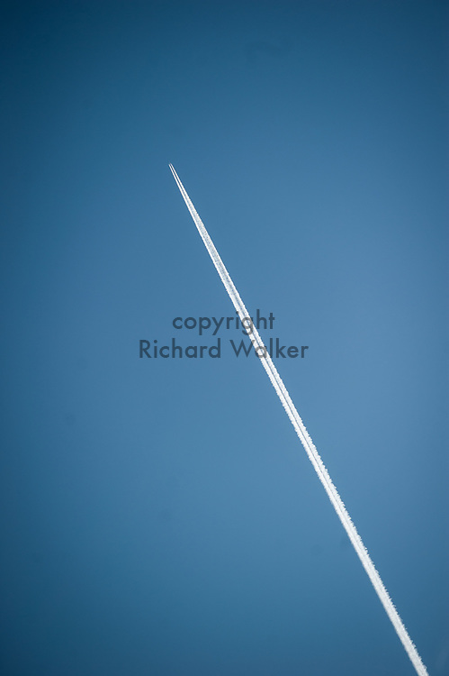 2017 DECEMBER 05 - An airplane leaves a contrail in winter against a blue sky, Seattle, WA, USA. By Richard Walker