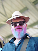 A Dulwich hamlet fan with a pink and blue beard. Dulwich Hamlet FC win promotion after a 4-3 penalty shootout against Hendon FC during the Bostik Premier League play off final on 7th May 2018 at Imperial Fields Stadium, South London in the United Kingdom. Dulwich Hamlet was founded in 1893 and both teams play in the Isthmian League Premier Division, a regional mens football league covering London, East and South East England. Next season they will play in the National League South.