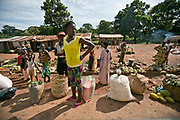 """Central Africans await a """"bush taxi"""" at an unmarked taxi stop along the highway between Bangui and Boali."""
