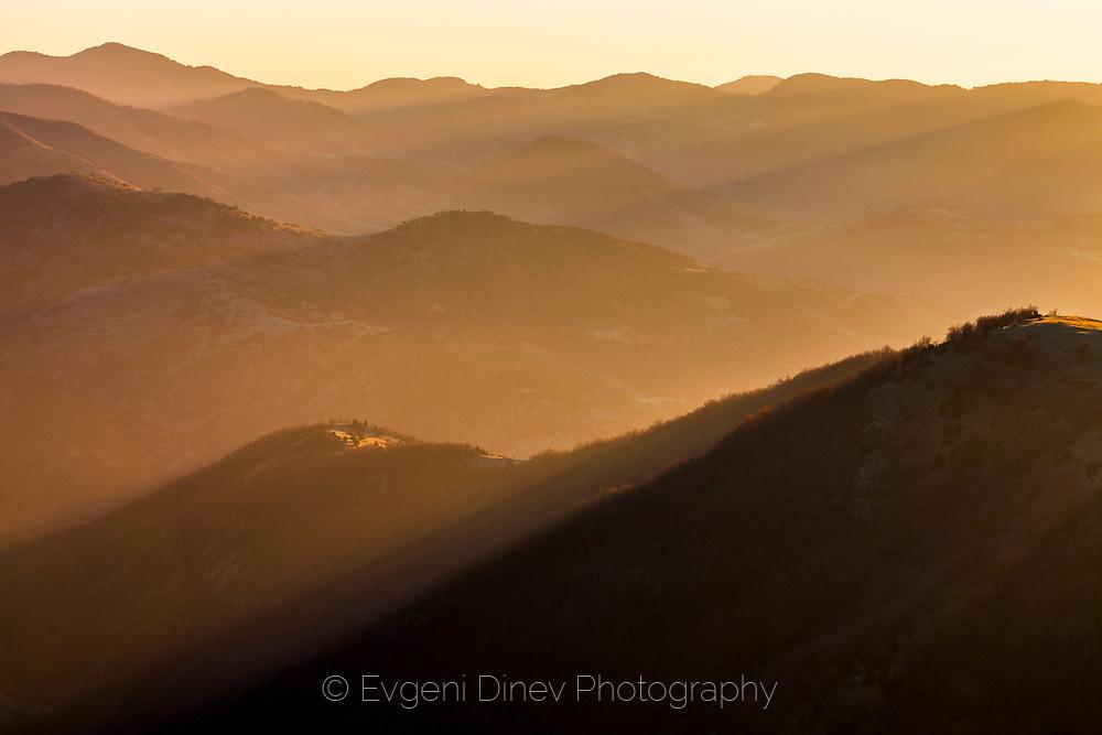 Mountain hills in golde sunlight