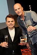 Officiele lancering van 100% NL TV in club Ziggo, Amsterdam.<br /> <br /> Op de foto: Roel van Velzen met een 100% NL beste videoclip TV Award, uitgereikt door Lex Gaarthuis