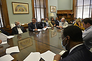 6/28/2020 Jackson MS. <br /> Pictured in the Speaker of the House's office is a group of MS State Senators meeting in Committee before  the historic vote to remove the Confederate Flag. Mississippi is the only State in the nation that has the Confederate symbol still on its flag. HB 1796 cleared the House and Senate clearing the way to remove the Confederate flag as the state flag for the State of Mississippi.   The Mississippi State legislators gathered at the State Capitol Sunday for a historic vote on HB1796. The MS House of Representatives  passed the Bill 91-23 and the MS Senate voted 31-14 in favor of changing the flag. The Bill would allow for the redesign of the Mississippi State Flag, the current flag has the Confederate symbol on it. Mississippi is the last State in the Nation to still have the racist Confederate symbol on its state flag. Black Lives Matter advocates celebrated the historic vote outside the Capitol. The Mississippi House of Representatives passed the Bill and so did the Mississippi Senate, Governor Tate Reeves said he would sign it if it passed. Photo © Suzi Altman