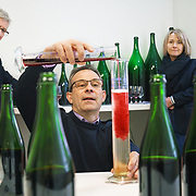 Séverine Frerson prepares to take over the role of cellar master from Hervé Deschamps (L) at champagne Perrier-Jouët. Deputy cellar master Eric Trichet is mixing the wines. Frerson will be the first woman at the helm in a row of seven male cellar masters before her. Founded in 1811 in Epernay, Maison Perrier-Jouët is one of France's most historic champagne houses, but also one of its most distinctive, renowned for its floral and intricate champagnes which reveal the true essence of the Chardonnay grape. Started in 1811, its cellars holds the world's two oldest known bottles of champagne, the 1825 vintage.