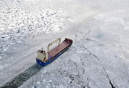 A ship makes its way through ice on the Hudson River south of the Mid-Hudson Bridge on Thursday, Jan. 22, 2009.