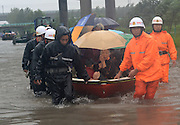 BEIJING, CHINA - JULY 20: <br /> <br /> Armed police officers and fire workers transfer trapped villagers at Nanshi Village on July 20, 2016 in Xingtai, Hebei Province of China. The Hebei Provincial Meteorological Bureau on Wednesday morning issued a red rainstorm alert, forecasting more heavy rains in the coming hours as several cities like Shijiazhuang, Handan, Xingtai have been affected severely in past two days<br /> ©Exclusivepix Media