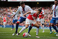 Alexis Sanchez of Arsenal shields the ball from Joel Ward of Crystal Palace. Barclays Premier league match, Arsenal v Crystal Palace at the Emirates Stadium in London on Sunday 17th April 2016.<br /> pic by John Patrick Fletcher, Andrew Orchard sports photography.