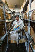 Factory manager Akira Shibata takes a cloisonne vase out of storage. Ando Cloisonne, Nagoya, Aichi Prefecture, Japan, February 26, 2018. Family-owned and run Ando Cloisonne was founded in the 1880s and is the only large manufacturer of cloisonne metalware left in Japan. The cloisonne enamelling process is technologically complex and a single work may feature over 50 colours.