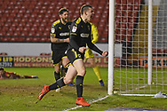 AFC Wimbledon defender Steve Seddon (15) scores a goal 0-1and celebrates during the EFL Sky Bet League 1 match between Walsall and AFC Wimbledon at the Banks's Stadium, Walsall, England on 12 February 2019.
