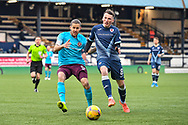 Regan Hendry (#8) of Raith Rovers FC and Peter Haring (#5) of Heart of Midlothian FC contest the ball during the SPFL Championship match between Raith Rovers and Heart of Midlothian at Stark's Park, Kirkcaldy, Scotland on 30 April 2021.