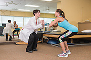 Dr. Jennifer Daily, photographed Friday, May 29, 2015 at the Centers for Primary Care at Cardinal Station, works with patient Kristie Deavins. Dr Daily is with UofL/KentuckyOne Health Sports Medicine and is assistant director of the Sports Medicine Fellowship Program. (Photo by Brian Bohannon)