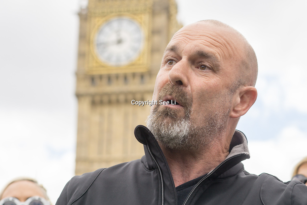 London,England,UK : 24th May 2016 : Speaker Mark Phillips Raystede centre for animal welfare at the Parliament Puppy Farming Protest - End The Third Party Sale Of Puppies! in Parliament Square, London. Photo by See Li