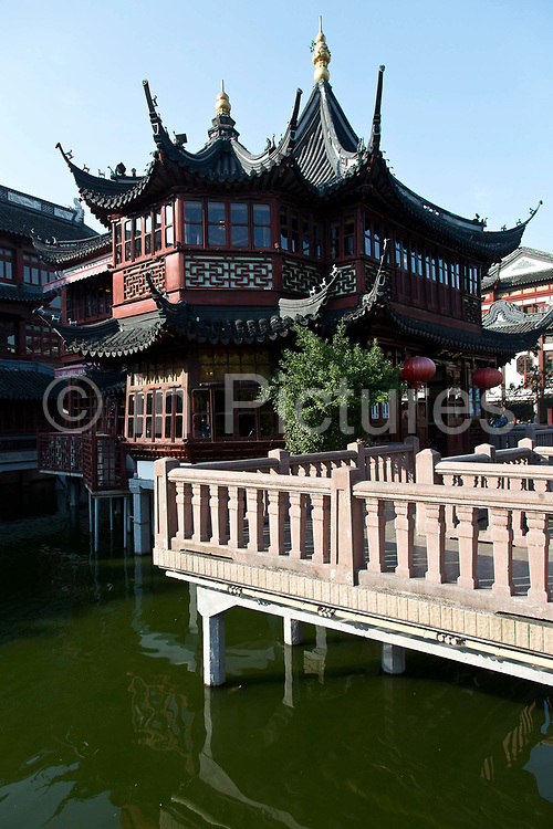 Huxinting Tea HouseA view of the Huxinting (Lake Center Pavilion) Tea House in the Yuyuan Gardens in Shanghai, China on 13 October 2013. Yuyuan and the surrounding Chenghuangmiao area represent the oldest vestige of Shanghai, having existed long before the British made Shanghai a treaty port and the most important economic hub in China.