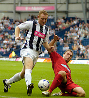 Photo: Ed Godden.<br />West Bromwich Albion v Colchester United. Coca Cola Championship. 19/08/2006. Steve Watson (L) colides with Colchester's Kevin Watson.