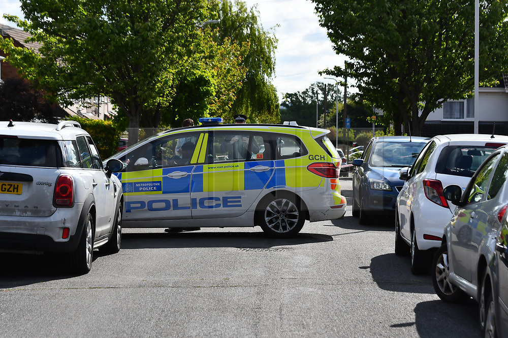 © Licensed to London News Pictures. 02/05/2020.  London UK:  Police officers in Upminster in Havering, East London seal off Kerry drive and surrounding areas after an 11 year old was shot at around 9.30 yesterday evening. He was rushed to hospital along with a male in his forties who suffered lacerations to the head , Photo credit: Steve Poston/LNP