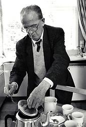 Elderly man making tea at day centre, Nottingham UK 1991