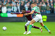Danny Amankwaa (#12) of Heart of Midlothian is held back by Filip Benkovic (#32) of Celtic FC during the Betfred League Cup semi-final match between Heart of Midlothian FC and Celtic FC at the BT Murrayfield Stadium, Edinburgh, Scotland on 28 October 2018.