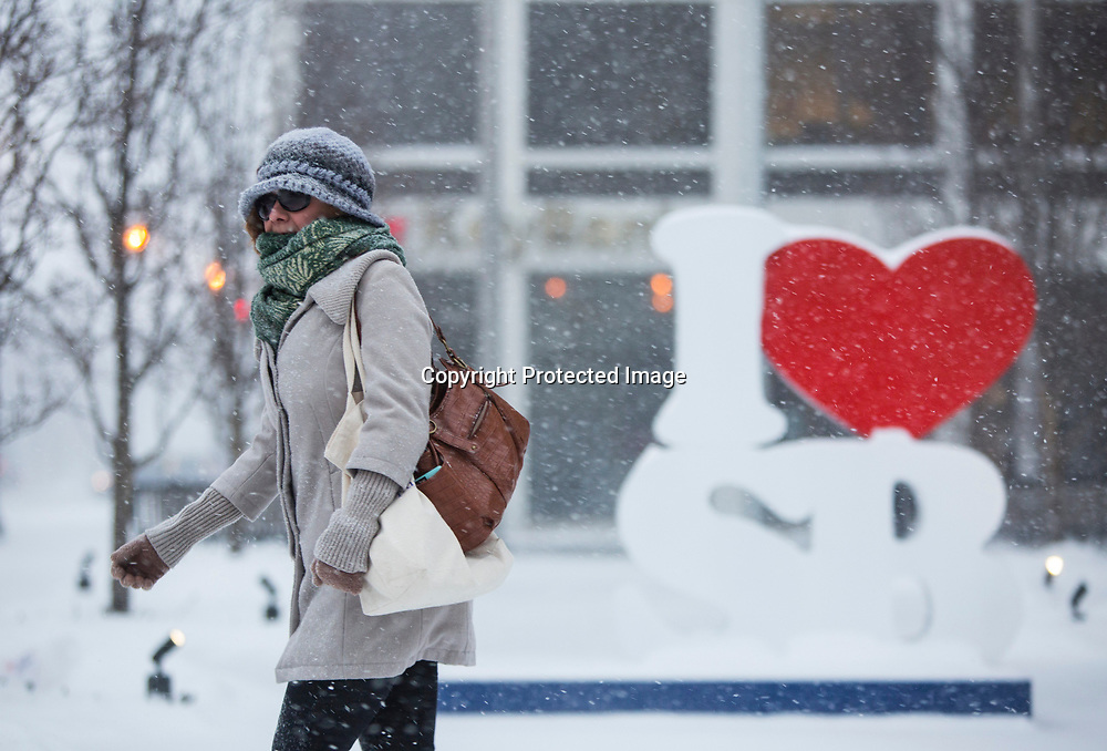 File: iheartSB011216b cmyk:  ID: 15059413  Placed on page: N  Cutline: Heather Mezosi walks to get coffee in a snowy downtown South Bend in January 2016. Forecasters said folks across the region may be in for more scenes like this during the upcoming winter season. Tribune File Photo/SANTIAGO FLORES  With story: 15059439  With story: 15059327