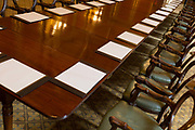 The long meeting table in the Locarno Room at the Foreign and Commonwealth Office FCO, on 17th September 2017, in Whitehall, London, England. In 1925 the Foreign Office played host to the signing of the Locarno Treaties, aimed at reducing tension in Europe. The ceremony took place in a suite of rooms that had been designed for banqueting, which subsequently became known as the Locarno Suite. During the Second World War, the Locarno Suites fine furnishings were removed or covered up, and it became home to a foreign office code-breaking department.