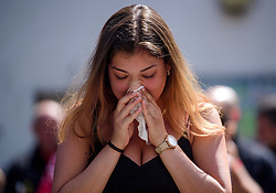 19/06/2017. London, UK. An emotional relative of fire victim  Jessica Urbano attends a minutes silence held near the scene of the Grenfell tower block fire. The blaze engulfed the 27-storey building killing dozens - with 34 people still in hospital, many of whom are in critical condition. Photo credit: Ben Cawthra *** Please Use Credit from Credit Field ***