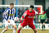 Photo: Chris Ratcliffe.<br />Colchester United v Swindon Town. Coca Cola League 1. 18/03/2006.<br />Pat Baldwin (L) of Colchester is held off the ball by Lee Peacock of Swindon