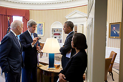 President Barack Obama, Vice President Joe Biden and National Security Advisor Susan E. Rice listen to  Secretary of State John Kerry following a bilateral meeting with European Council President Donald Tusk in the Oval Office, March 9, 2015. (Official White House Photo by Pete Souza)<br /> <br /> This official White House photograph is being made available only for publication by news organizations and/or for personal use printing by the subject(s) of the photograph. The photograph may not be manipulated in any way and may not be used in commercial or political materials, advertisements, emails, products, promotions that in any way suggests approval or endorsement of the President, the First Family, or the White House.