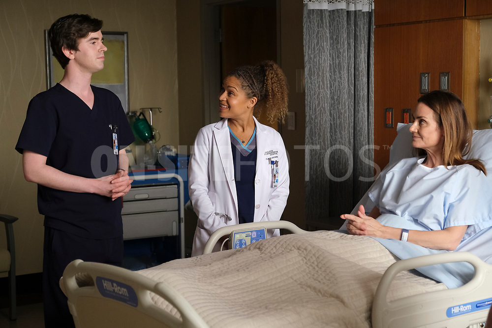 """THE GOOD DOCTOR - """"Gender Reveal"""" – After finding out the gender of their unborn child, Lea's enthusiasm prompts Shaun to make an effort to be a more supportive partner. Meanwhile, the team treats a navy pilot whose previous doctor's misdiagnosis compromises her chances at a full recovery on an all-new episode of """"The Good Doctor,"""" MONDAY, APRIL 19 (10:00-11:00 p.m. EDT), on ABC. (ABC/Jeff Weddell)<br /> FREDDIE HIGHMORE, ANTONIA THOMAS, DIANE FARR"""