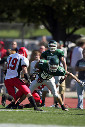 04 October 2008: Martin Ceisel is caught from behind by a Red Man after being slowed by Chas Walton in a battle between the Carthage Red Men and the Illinois Wesleyan University Titans, Game action was at Wilder Field on the campus of Illinois Wesleyan University in Bloomington Illinois.