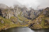 Mountain peaks shrouded in fog, Routeburn Track, South Island, New Zealand