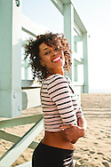 Portrait of a pretty African American woman at the beach.