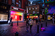 The neon light streets of Soho on the last day before the second national coronavirus lockdown on 4th November 2020 in London, United Kingdom. The new national lockdown is a huge blow to the economy and for individuals who were already struggling, as Covid-19 restrictions are put in place until 2nd December across England, with all non-essential businesses closed.