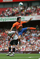 Photo: Lee Earle.<br /> Inter Milan v Valencia. The Emirates Cup. 28/07/2007.Inter's Ivan Fatic (L) clashes with David Silva.