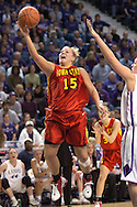 Iowa State's Heather Ezell (15) scores past Kansas State's Jessica McFarland (R) in the first half at Bramlage Coliseum in Manhattan, Kansas, February 11, 2006.  The Cyclones defeated the Wildcats 71-66.