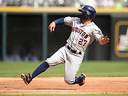 CHICAGO - AUGUST 13:  Jose Altuve #27 of the Houston Astros slides safely into third base against the Chicago White Sox during the first game of a doubleheader on August 13, 2019 at Guaranteed Rate Field in Chicago, Illinois.  (Photo by Ron Vesely)  Subject:   Jose Altuve